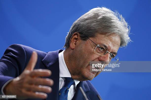 The new Italian Prime Minister Paolo Gentiloni speaks during a joint press conference with Germany Chancellor Angela Merkel at the Chancellery on...