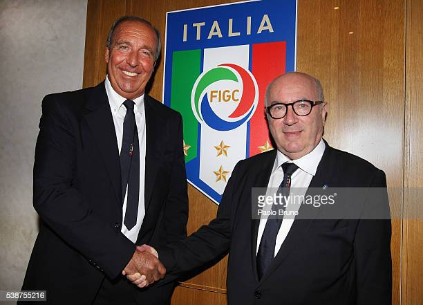 The new Italy head coach Giampiero Ventura shakes hands with FIGC President Carlo Tavecchio on June 8 2016 in Rome Italy