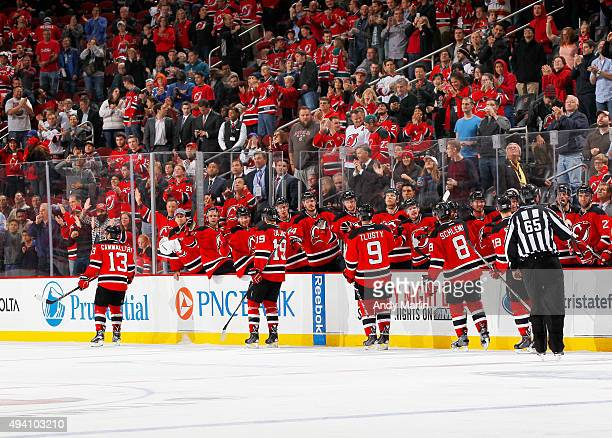The New Jersey Devils and their fans celebrate a goal by Mike Cammalleri against the Arizona Coyotes during the game at the Prudential Center on...