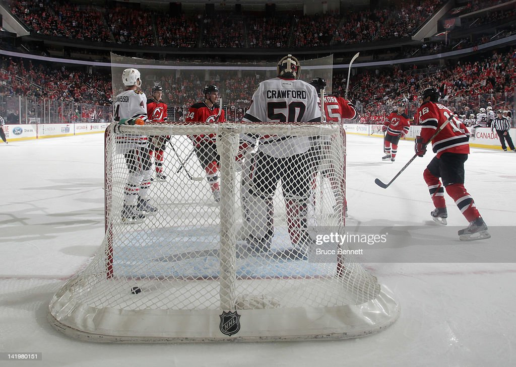 The New Jersey Devils celebrate a first period goal by <a gi-track='captionPersonalityLinkClicked' href=/galleries/search?phrase=Petr+Sykora&family=editorial&specificpeople=202186 ng-click='$event.stopPropagation()'>Petr Sykora</a> #15 against the Chicago Blackhawks at the Prudential Center on March 27, 2012 in Newark, New Jersey. The Devils defeated the Blackhawks 2-1 in the shootout.