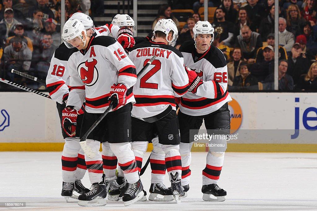 The New Jersey Devils celebrate a goal against the Boston Bruins at the TD Garden on October 26, 2013 in Boston, Massachusetts.
