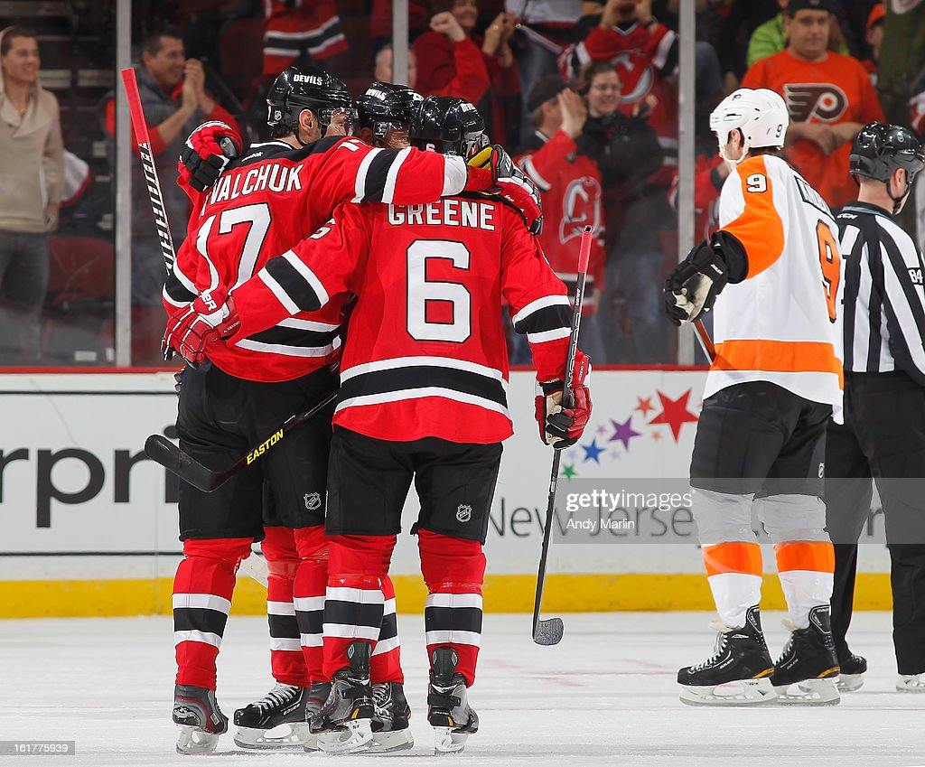 The New Jersey Devils celebrate a goal as Mike Knuble #9 of the Philadelphia Flyers looks away during the game at the Prudential Center on February 15, 2013 in Newark, New Jersey.