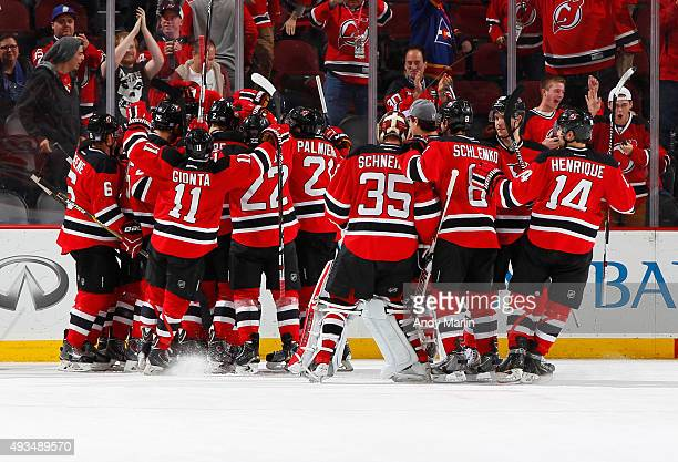 The New Jersey Devils celebrate after defeating the Arizona Coyotes in overtime at the Prudential Center on October 20 2015 in Newark New Jersey The...