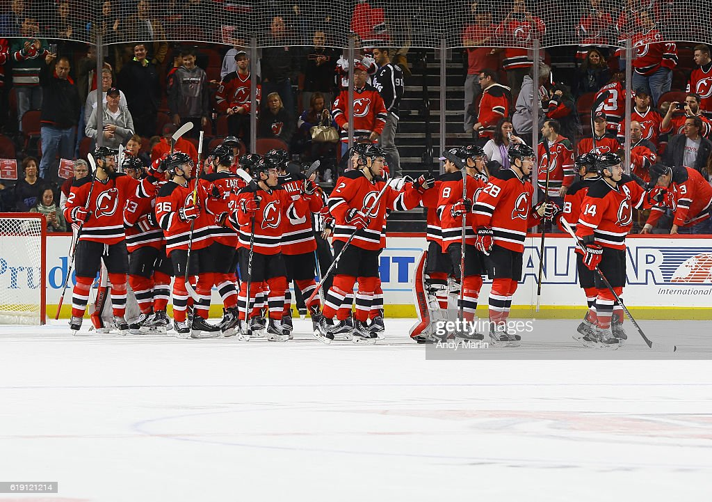 The New Jersey Devils celebrate after defeating the Tampa Bay Lightning at Prudential Center on October 29, 2016 in Newark, New Jersey. The Devils defeated the Lighjtning 3-1.