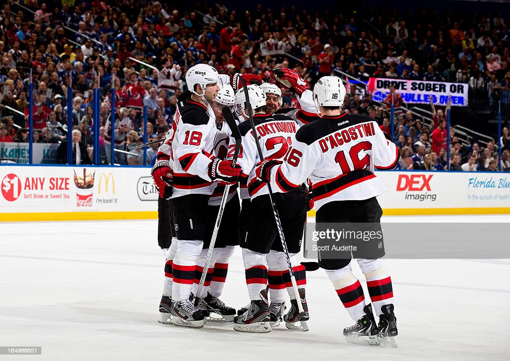 The New Jersey Devils celebrate after scoring during the second period of the game against the Tampa Bay Lightning at the Tampa Bay Times Forum on March 29, 2013 in Tampa, Florida. The second period wrapped up with a tie game, 2-2.