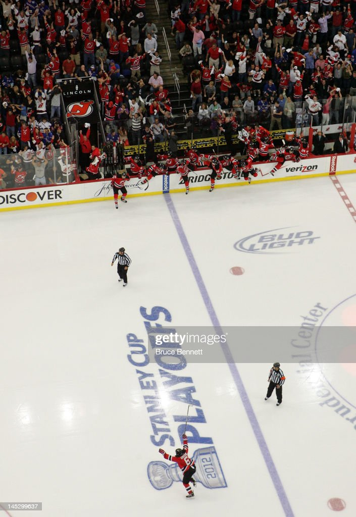 The New Jersey Devils celebrate after the game winning goal by Adam Henrique in overtime against the New York Rangers to win Game Six of the Eastern...