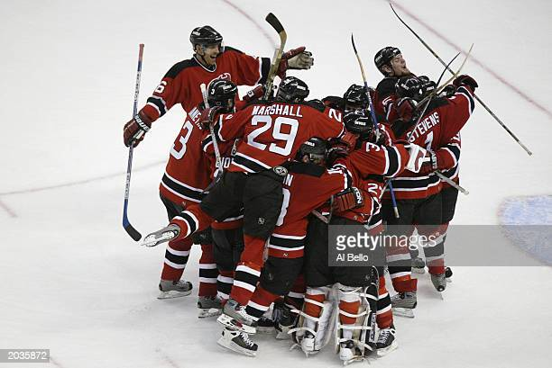 The New Jersey Devils celebrate their 32 victory over the Ottawa Senators after game 7 of the NHL Eastern Conference Finals of the 2003 Stanley Cup...