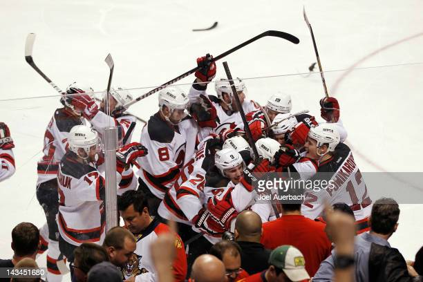 The New Jersey Devils celebrate their double overtime win against the Florida Panthers in Game Seven of the Eastern Conference Quarterfinals during...