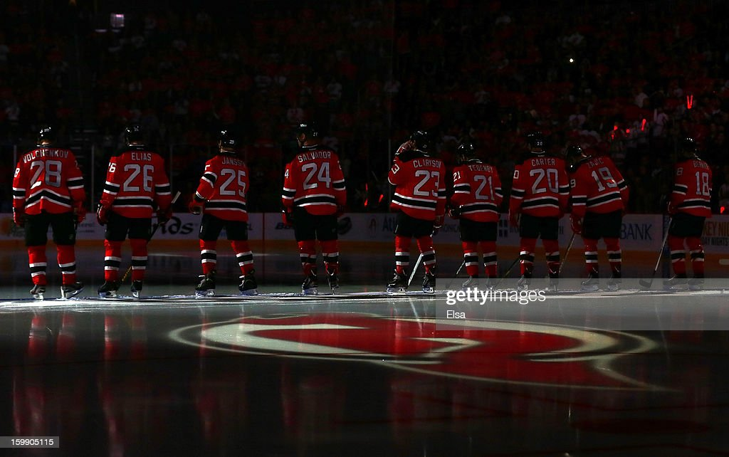 The New Jersey Devils line up for team introductions before the season opener against the Philadelphia Flyers at the Prudential Center on January 22, 2013 in Newark, New Jersey.