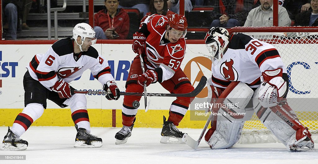 The New Jersey Devils' Martin Brodeur (30) and Andy Greene (6) defend the goal against the Carolina Hurricanes' Jeff Skinner (53) during the first period at the PNC Arena in Raleigh, North Carolina, on Thursday, March 21, 2013.