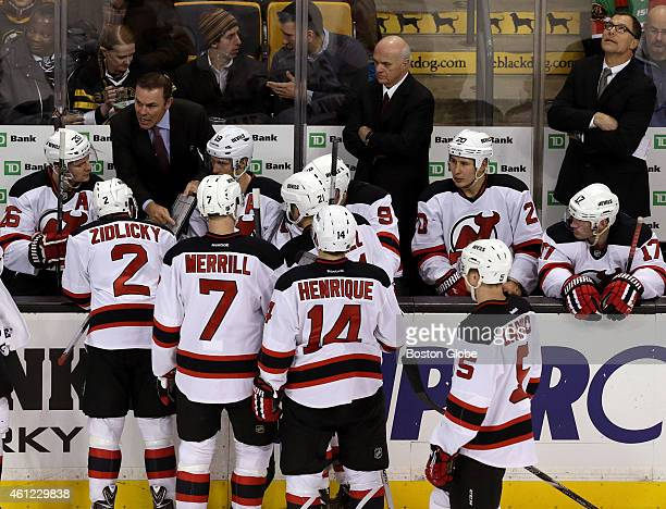 The New Jersey Devils new coaching trio consisting of Adam Oates General Manager Lou Lamoriello and Scott Stevens on the Devils bench during a time...