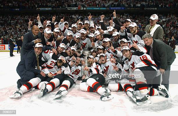 The New Jersey Devils pose with the Stanley Cup after defeating the Mighty Ducks of Anaheim in game seven of the 2003 Stanley Cup Finals at...