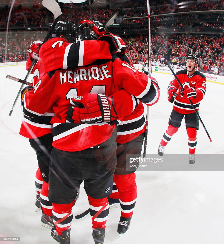 The New Jersey Devils react after <a gi-track='captionPersonalityLinkClicked' href=/galleries/search?phrase=Adam+Larsson&family=editorial&specificpeople=6705080 ng-click='$event.stopPropagation()'>Adam Larsson</a> #5 (not pictured) scored the game winning goal in the third period against the Columbus Blue Jackets during the game at the Prudential Center on November 1, 2014 in Newark, New Jersey. The Devils defeated the Blue Jackets 3-2.