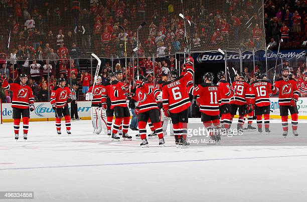 The New Jersey Devils salute the fans after defeating the Vancouver Canucks in overtime at the Prudential Center on November 8 2015 in Newark New...