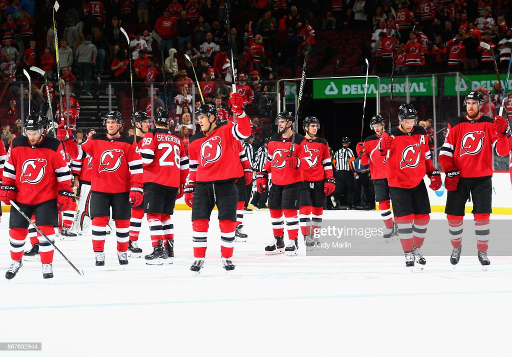 The New Jersey Devils salute the fanss after defeating the Arizona Coyotes at Prudential Center on October 28, 2017 in Newark, New Jersey.