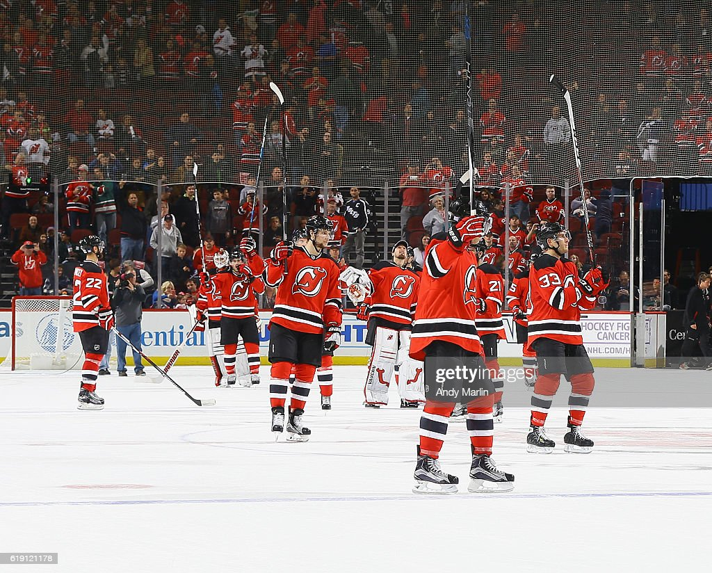 The New Jersey Devils salute their fans after defeating the Tampa Bay Lightning at Prudential Center on October 29, 2016 in Newark, New Jersey. The Devils defeated the Lighjtning 3-1.