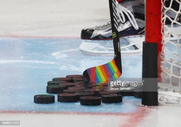 The New Jersey Devils skate in warmups prior to the game against the Montreal Canadiens with their sticks decorated for 'Hockey is for Everyone'...