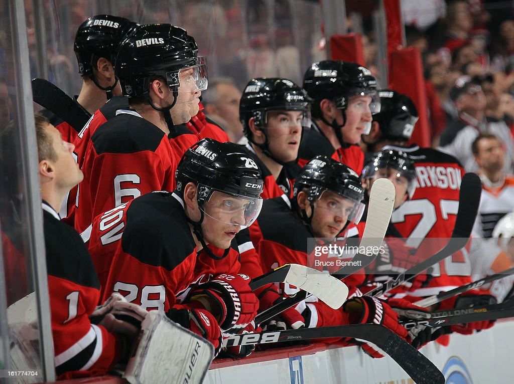 The New Jersey Devils watch the closing minute of a 5-3 victory over the Philadelphia Flyers at the Prudential Center on February 15, 2013 in Newark, New Jersey.