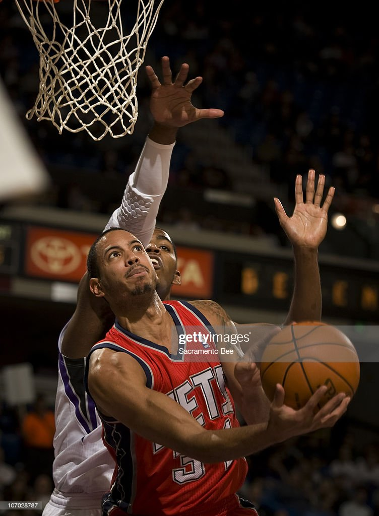 The New Jersey Nets' Devin Harris is fouled by the Sacramento Kings' Jason Thompson in the second quarter at Arco Arena in Sacramento, California, on Friday, November 19, 2010.