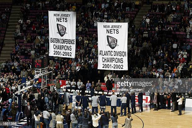 The New Jersey Nets raise the 20012002 Alantic Division and the Eastern Conference Championship banners at their home opener against the Atlanta...