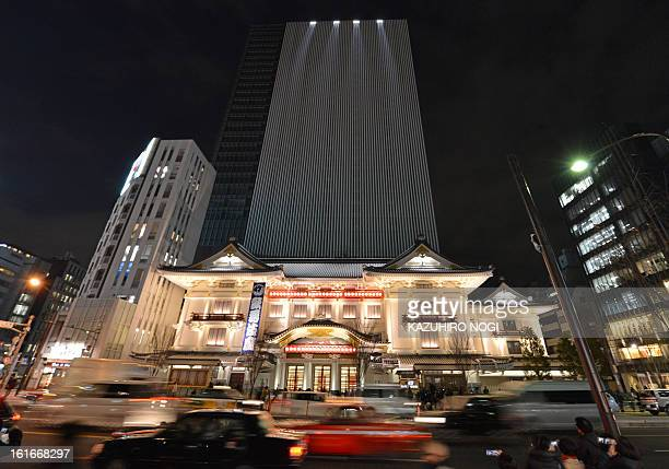 The new Kabukiza theatre part of a 29storey office building in the upscale Ginza shopping district is illuminated ahead of its April opening in Tokyo...