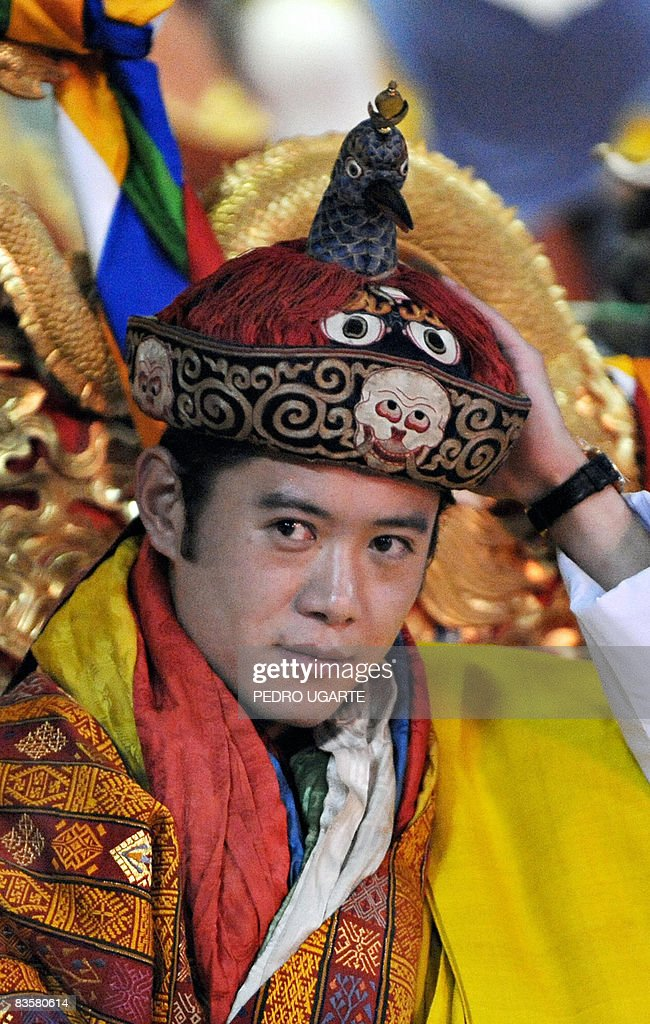 The new king of Bhutan, <a gi-track='captionPersonalityLinkClicked' href=/galleries/search?phrase=Jigme+Khesar+Namgyel+Wangchuck&family=editorial&specificpeople=737466 ng-click='$event.stopPropagation()'>Jigme Khesar Namgyel Wangchuck</a>, holds his crown at the Tashichho Dzong Palace in Thimphu on November 6, 2008. The isolated Himalayan kingdom of Bhutan crowned a new king, placing a charismatic Oxford-educated bachelor as head of state of the world's newest democracy. Twenty-eight year-old <a gi-track='captionPersonalityLinkClicked' href=/galleries/search?phrase=Jigme+Khesar+Namgyel+Wangchuck&family=editorial&specificpeople=737466 ng-click='$event.stopPropagation()'>Jigme Khesar Namgyel Wangchuck</a> also becomes the world's youngest reigning monarch. AFP PHOTO/PEDRO UGARTE