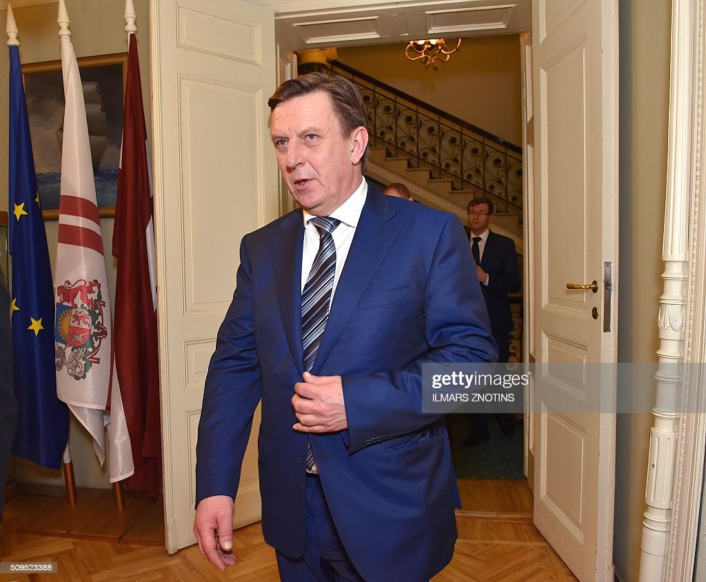 The new Latvian Prime Minister Maris Kucinskis walks after his election at the Parliament of Latvia in Riga on February 11, 2016. / AFP / afp / Ilmars Znotins