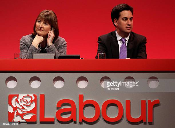 The new leader of the Labour Party Ed Miliband and deputy leader Harriet Harman listen to a tribute to Michael Foot a former Labour leader who passed...