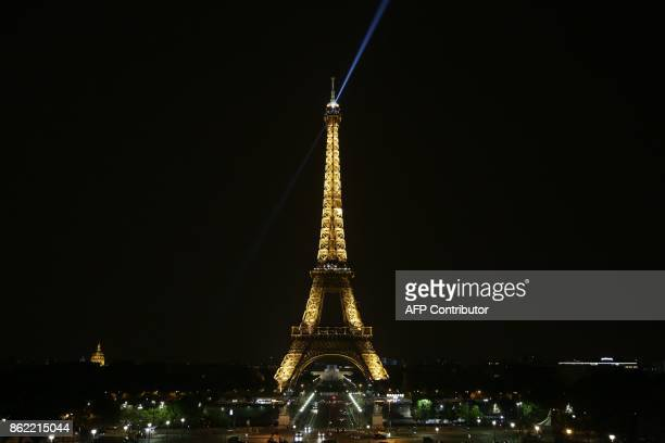The new 'lighthouse' beams at the top of the Eiffel Tower that lights up the night sky in the French capital Paris between 10pm and 1am projects...