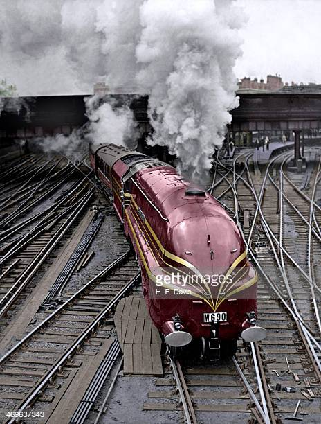 The new LMS streamlined locomotive Duchess of Gloucester leaves Euston Station in London on her first long distance journey 8th June 1938 She is...