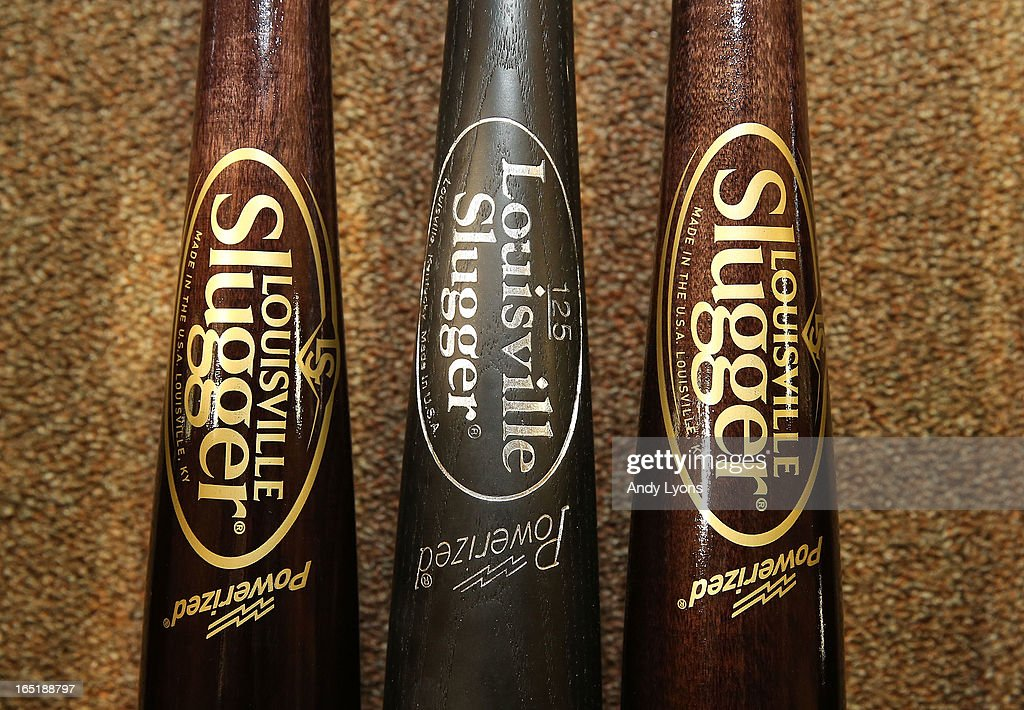 The new logo for the Louisville Slugger bat is on display on the bats on the left and right with the old logo from last year in the middle inside the Louisville Slugger Museum and Plant on April 1, 2013 in Louisville, Kentucky.