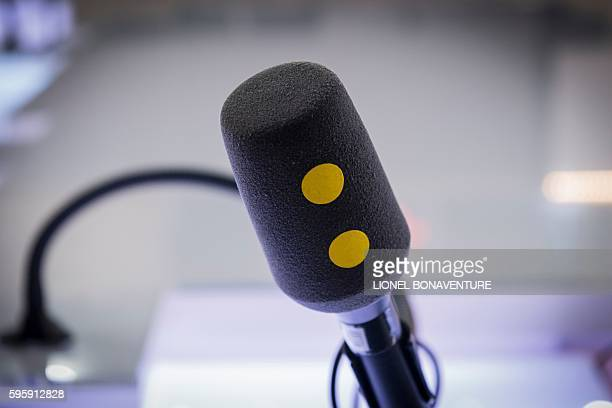 The new logo of Franceinfo is seen on a microphone on August 26 2016 at the French public service radio broadcaster Radio France's headquarters at...