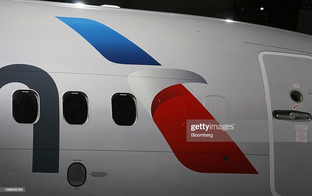The new logo on an American Airlines Inc. Boeing Co. 737-800 plane is seen during an event at Dallas-Fort Worth International Airport in Fort Worth, Texas, U.S., on Thursday, Jan. 17, 2013. American Airlines unveiled the first change in its aircraft livery in more than 40 years as it nears a decision on merging with US Airways Group Inc. or trying to leave bankruptcy on its own. Photographer: Mike Fuentes/Bloomberg via Getty Images