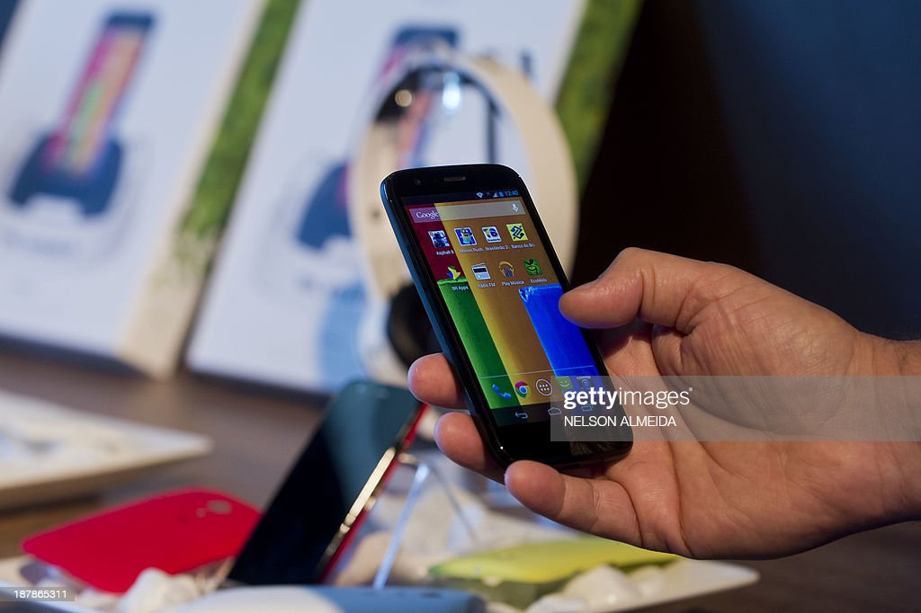 The new low cost smartphone of Motorola, 'Motorola Moto G', is displayed in Sao Paulo, Brazil on November 13, 2013. The smartphone, with dimensions 65.9mm W x 129.9mm H x 6.0 - 11.6mm D is equipped with a Qualcomm Snapdragon 400 with quad-core 1,2 GHz CPU, a 4.5-inch display and Android Operating System 4.3 and a suggested price of $ 179 USD.