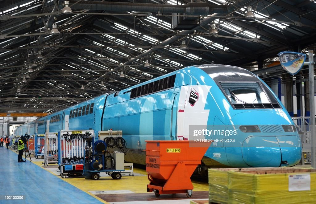 The new low-cost TGV high-speed train 'Ouigo' enters the assembling plant in Bischheim, eastern France, on February 19, 2013. France's state rail firm SNCF opened its online booking service for its new budget train service 'Ouigo' on February 19 inspired by the budget airline model. The train will start transporting its first passengers from April 2, with the Ouigo service operating from Marne-la-Vallée near Disneyland Paris, Lyon-Saint-Exupéry airport, Marseilles and Montpellier.