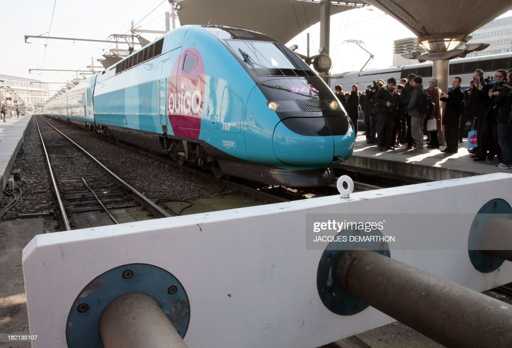 The new low-cost TGV high-speed train 'Ouigo' is seen at the Gare de Lyon railway station in Paris on February 19, 2013. France's state rail firm SNCF opened its online booking service for its new budget train service 'Ouigo' on February 19 inspired by the budget airline model. The train will start transporting its first passengers from April 2, with the Ouigo service operating from Marne-la-Vallée near Disneyland Paris, Lyon-Saint-Exupéry airport, Marseilles and Montpellier.