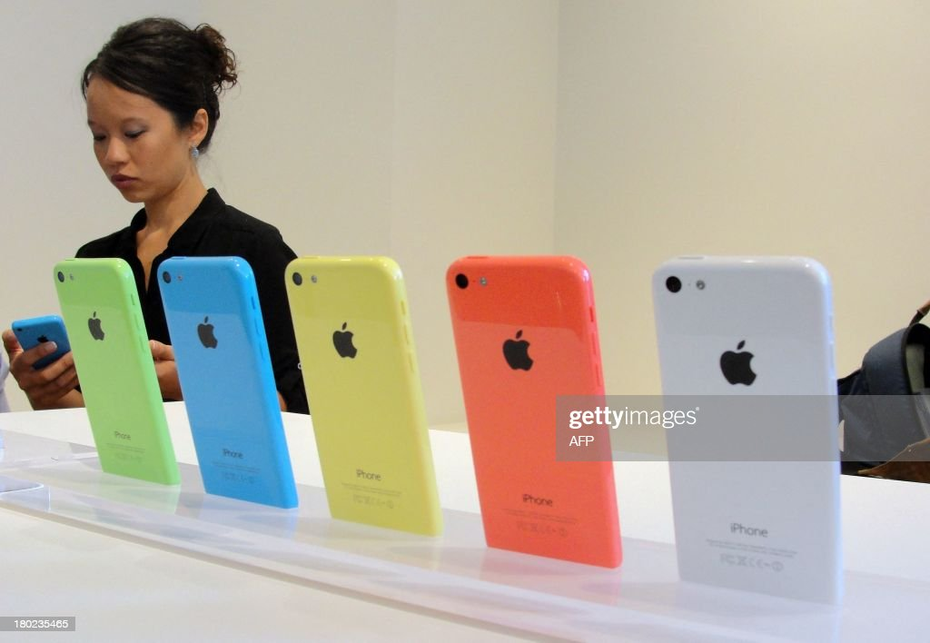 The new lower-cost iPhone 5C will debut in a set of lively colors at an iPhone event at Apple's headquarters in Silicon Valley on September 10, 2013 in Cupertino, California. Apple unveiled two new iPhones on Tuesday in its bid to expand its share of the smartphone market, including one as low as $99 with a US carrier contract. 'The business has become so large that this year we are going to replace the iPhone 5 and we are going to replace it with two new designs,' Apple chief Tim Cook announced at the company's Silicon Valley headquarters. Apple will begin taking orders on Friday, and on September 20 the two devices will go on sale in the United States, Australia, Britain, China, France, Germany, Japan and Singapore.