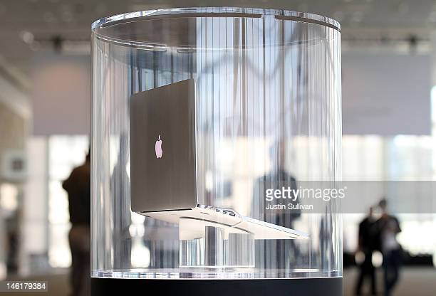 The new MacBook Pro is displayed in a case following the keynote address at the Apple 2012 World Wide Developers Conference at Moscone West on June...