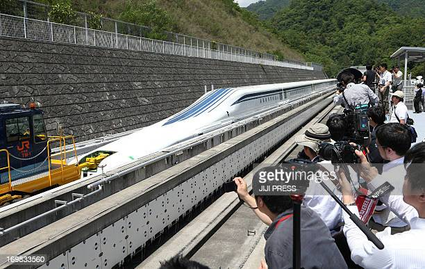 The new maglev train 'L0 series' is displayed on an experimental track in Tsuru in Yamanashi prefecture 100km west of Tokyo on June 3 2013 Central...
