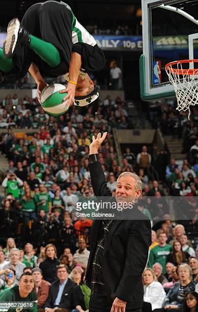 The new manager for the Boston Red Sox Bobby Valentine helps out the mascot Lucky for a trick during a time out of the Boston Celtics against the...