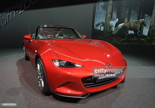 The new Mazda Roadster MX5 is presented at the 2014 Paris Auto Show on October 3 2014 in Paris AFP PHOTO/MIGUEL MEDINA