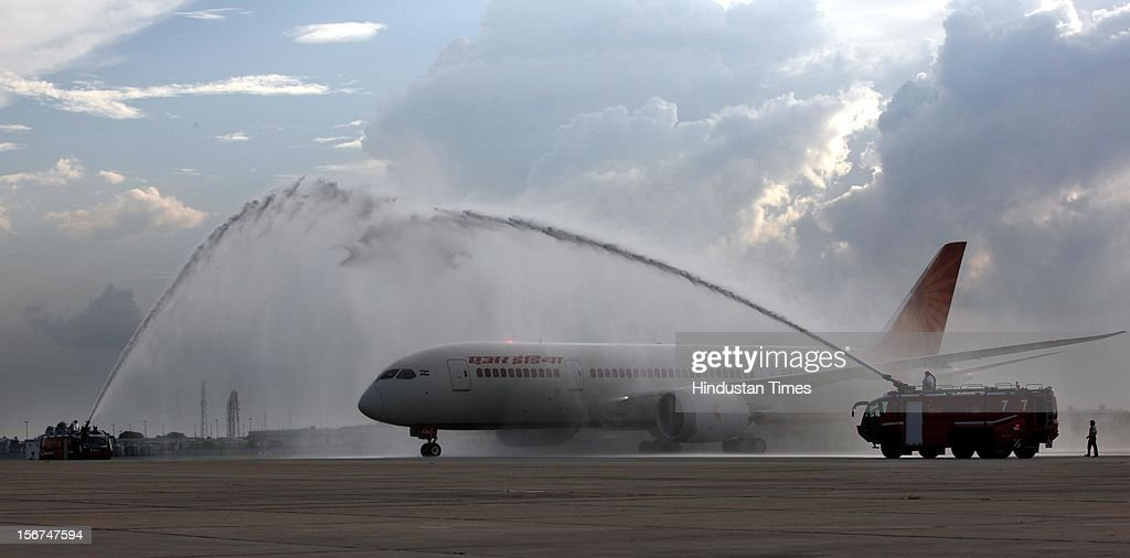 'NEW DELHI, INDIA - SEPTEMBER 8: The new member of Air India fleet advanced Boeing 787 Dreamliner given water-cannon salute as it taxied to the bay at IGI airport on September 8, 2012 in New Delhi, India. (Photo by Raj k Raj/Hindustan Times via Getty Images)'