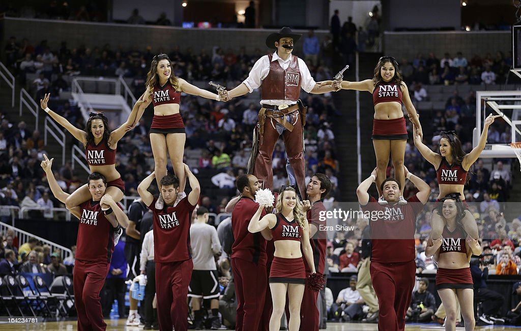 The New Mexico State Aggies cheer team performs in the second half against the Saint Louis Billikens during the second round of the 2013 NCAA Men's Basketball Tournament at HP Pavilion on March 21, 2013 in San Jose, California.