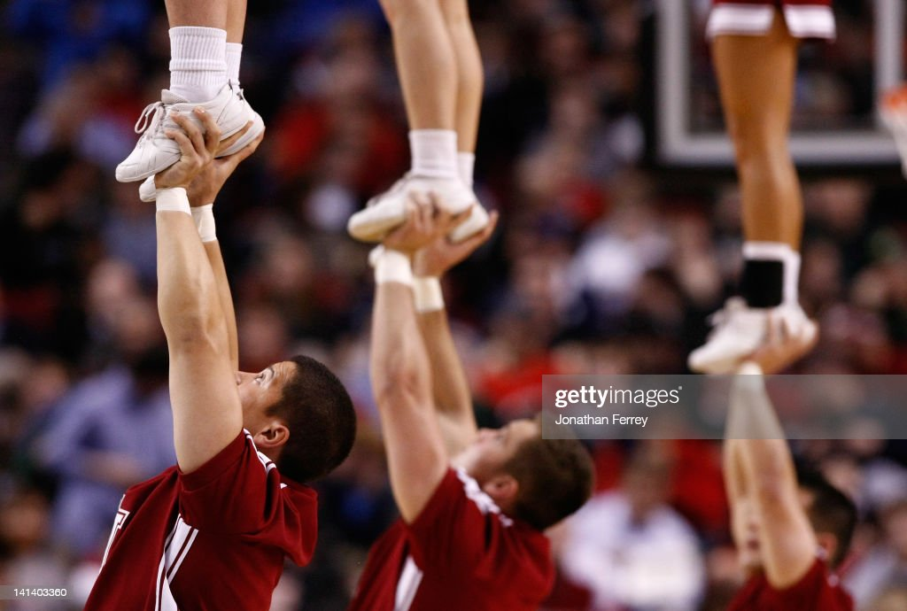 The New Mexico State Aggies cheerleaders perform during a break in the game against the Indiana Hoosiers in the second round of the 2012 NCAA men's basketball tournament at Rose Garden Arena on March 15, 2012 in Portland, Oregon.