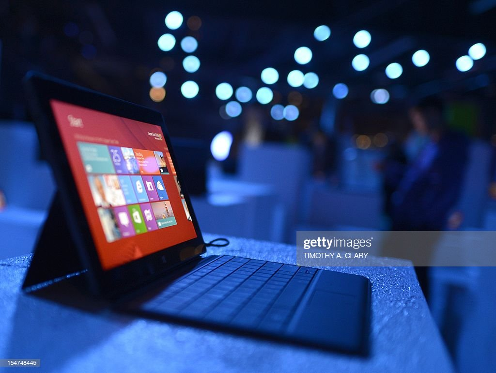 The new Microsoft Surface tablet on display following a press conference at Pier 57 to officially launch Windows 8 and the tablet in New York on October 25, 2012. Microsoft took a big step into mobile Thursday, unveiling a revamped version of its flagship Windows system and a offering a closer look at Surface, its entry into the hot tablet market. The new Windows 8 operating system and tablet to go on sale Friday mark a new offensive for the US tech giant seeking to keep pace with Apple and Google amid a dramatic shift away from PCs to mobile devices.