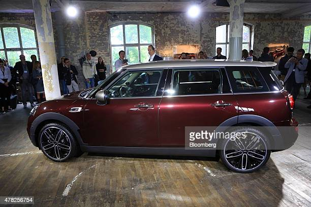 The new Mini Clubman automobile manufactured by Bayerische Motoren Werke AG stands illuminated as it is unveiled in Berlin Germany on Wednesday June...