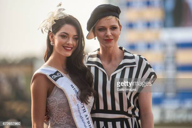 The new Miss SA DemiLeigh NelPieters poses with Princess Charlene of Monaco during the Princess Charlene Ladies Day at Turfontein Race course on...