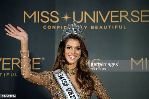 The new Miss Universe Iris Mittenaere of France waves to photographers during a press conference after being crowned the winner at the Miss Universe...