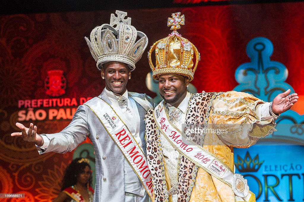 The new Momo King of Sao Paulo's Carnival, Gledson Fonseca (L) poses with his predecessor during the competition for new King, Queen and Princess of the Carnival parade in Sao Paulo, Brazil, late on January 17, 2013. Sao Paulo's carnival is scheduled for February 8 and 9.
