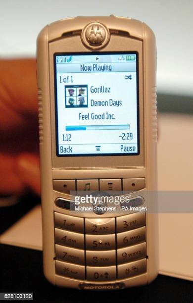 The new Motorola phone is held at a press launch in London Wednesday September 7 2005 The phone which also plays iTunes was unveiled tonight along...